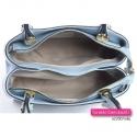 Włoski jasnobłękitny skórzany kuferek w pastelowym modnym odcieniu