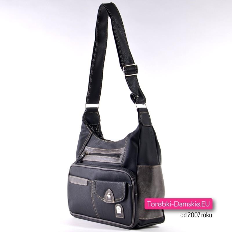 f601d63101c29 Czarna praktyczna torebka dużą ilością kieszeni · Torebka listonoszka na  szerokim długim pasku ...